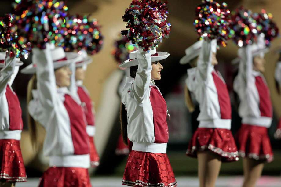 Members of the Tomball drill team wave the home crowd  before the  first half of Tomball and Reagan  Class 4A Division I playoff match-up at Tomball Independent School District Stadium. Thursday, Nov. 15, 2012, in Tomball. Photo: Billy Smith II, Houston Chronicle / © 2012 Houston Chronicle