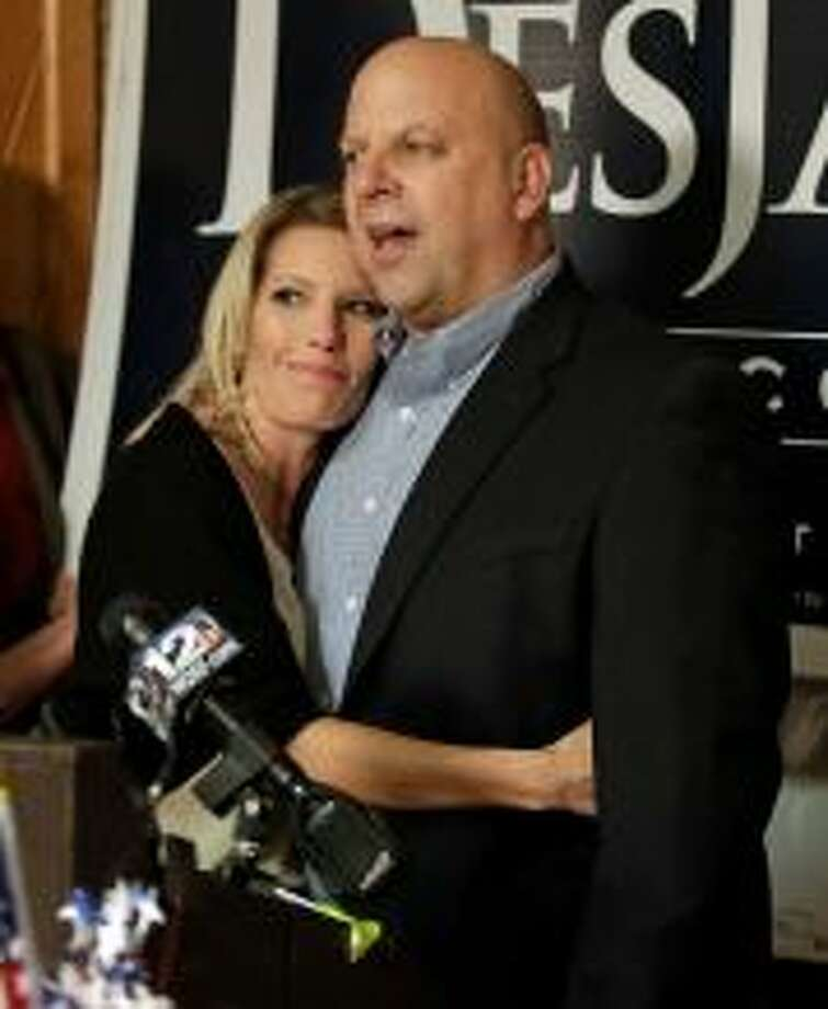 "FILE -- In this Nov. 6, 2012 file photo, U.S. Rep. Scott DesJarlais, R-Tenn., gets a hug from his current wife, Amy, as he speaks to supporters on election night in Winchester, Tenn. DesJarlais defeated Democrat Eric Stewart in the state's 4th Congressional District race. DesJarlais testified during divorce proceedings that he and his former wife, Susan, made a ""mutual"" decision for her to have two abortions, according to divorce transcripts released Thursday, Nov. 15, 2012. Photo: Mark Humphrey/file / AP"