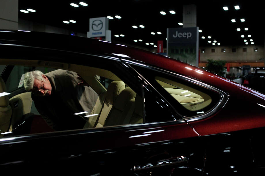 Kimble Compton looks at a 2013 Toyota Avalon on display during the San Antonio Auto and Truck Show at the Henry B. Gonzalez Convention Center on Thursday, Nov. 15, 2012. Photo: Lisa Krantz, San Antonio Express-News / © 2012 San Antonio Express-News