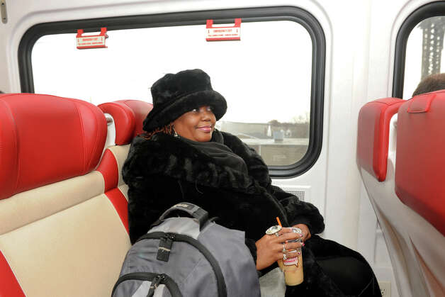 Veronica Diggs, of Bridgeport, rides Metro North a couple of times a week to visit family in New Rochelle, NY. She is seen here on one of the new M-8 trains as it leaves Bridgeport, Conn. Nov. 15th, 2012. She said she likes the new trains. Photo: Ned Gerard / Connecticut Post