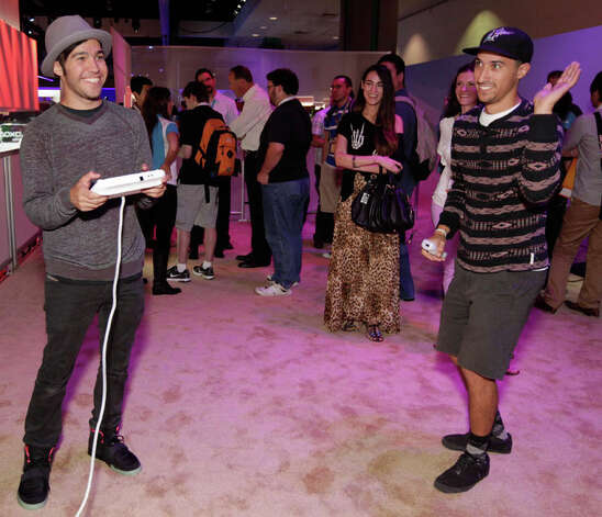 FILE - In this June 7, 2012 publicity file photo provided by Nintendo, Pete Wentz, left, and guests get an exclusive preview of Nintendo's Wii U during E3 in Los Angeles. (AP Photo/Nintendo,Todd Williamson) Photo: Todd Williamson