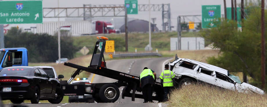 A wrecker crew prepares to tow a Jeep sport utility vehicle after it rolled over on Loop 410 near Somerset road Friday morning. A two-year-old girl was critically injured in the wreck when she was ejected from the vehicle while still in her car seat. The 9:10 a.m. accident also injured a 5-year-old boy and the female driver of the vehicle. Police said all three were going west in the vehicle when the woman lost control and clipped an 18-wheeler. All three were hospitalized.  / ©San Antonio Express-News/Photo Can Be Sold to the Public