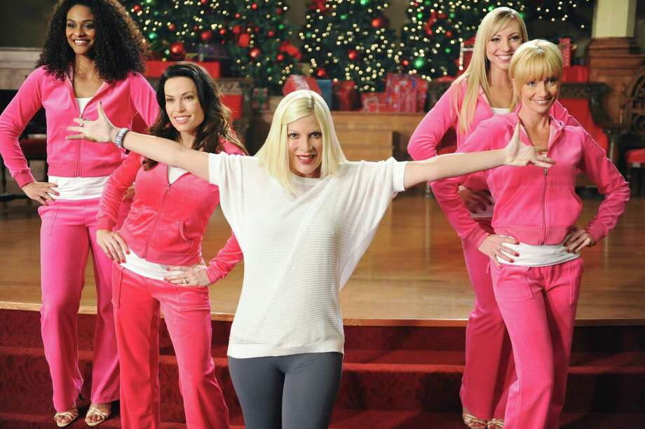 "This image released by ABC Family shows Tori Spelling, center, in a scene from the ABC Family original holiday musical, ""The Mistle-Tones,"" also starring Tia Mowry.  The special is part of the network's ""25 Days of Christmas""  Premiering Sunday, Dec. 9  at 8:00 p.m. EST. (AP Photo/ABC Family, Fred Hayes) Photo: Fred Hayes, HOEP / ABC Family"