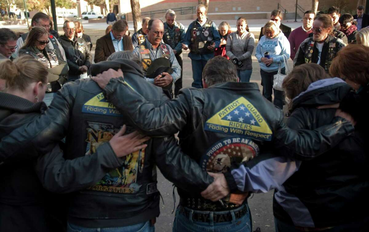 Patriot Guard riders gather Friday, Nov. 16, 2012, in Midland, Texas, as ride captain Ductape leads them in prayers for the victims and their families of the veterans parade accident Thursday, where four veterans were killed and 16 other people were injured when a train slammed into a parade float carrying the returning heroes to a banquet. (AP Photo/Reporter-Telegram, Tim Fischer)