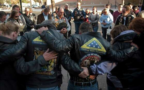 Patriot Guard riders gather Friday, Nov. 16, 2012, in Midland, Texas, as ride captain Ductape leads them in prayers for the victims and their families of the veterans parade accident Thursday, where four veterans were killed and 16 other people were injured when a train slammed into a parade float carrying the returning heroes to a banquet. (AP Photo/Reporter-Telegram, Tim Fischer) Photo: Tim Fischer, Associated Press / Reporter-Telegram