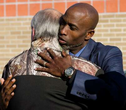 Pastor Roy Smith comforts Terry Johnson, Friday, Nov. 16, 2012, in Midland, Texas, following a community prayer service for all those involved in an incident Thursday, where four veterans were killed and 16 other people were injured when a train slammed into a parade float carrying the returning heroes to a banquet. (AP Photo/Reporter-Telegram, Tim Fischer) Photo: Tim Fischer, Associated Press / Reporter-Telegram