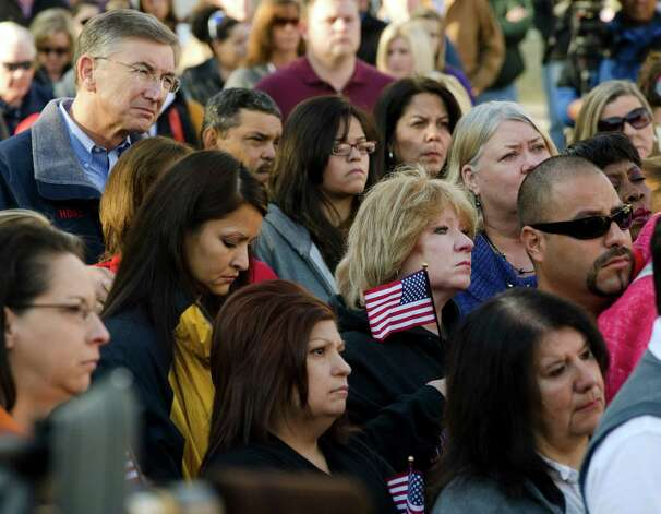 Hundreds gather early Friday, Nov. 16, 2012, in Midland, Texas, some holding flags, for a prayer service to honor and pray for all those involved in the incident on Thursday where four veterans were killed and 16 other people were injured when a train slammed into a parade float carrying the returning heroes to a banquet. (AP Photo/Reporter-Telegram, Tim Fischer) Photo: Tim Fischer, Associated Press / Reporter-Telegram