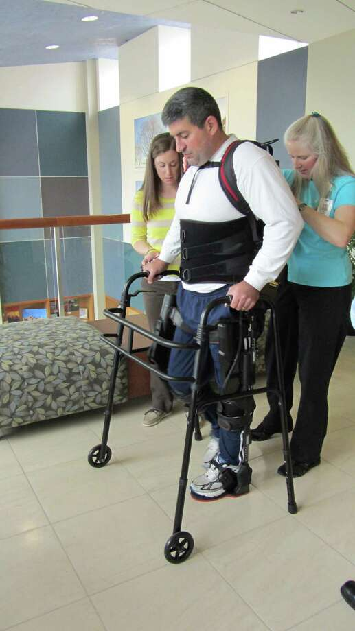 Mike Loura demonstrates exoskeleton that can be used to help those suffering from paralysis walk again. Nov. 8, 2012. Photo: Contributed