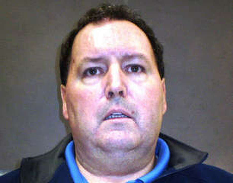 Michael Hayes, 53, of 119 Coram Lane in Orange, turned himself in to police Thursday on a warrant charging him with two counts of embezzlement. He is accused of taking $125,000 from a life insurance payment his client received for her dead husband and $50,000 from a second client and bought a house for cash. Photo: Milford Police Department
