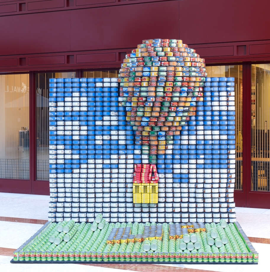 """Look UP, Flying CANnes (Hunstman, Rutherford + Chekene): """"UP rises even higher at CANstruction: recreating the journey using almost 5,000 food cans to depict the house, sky, clouds and balloons from Pixar's """"Up."""""""