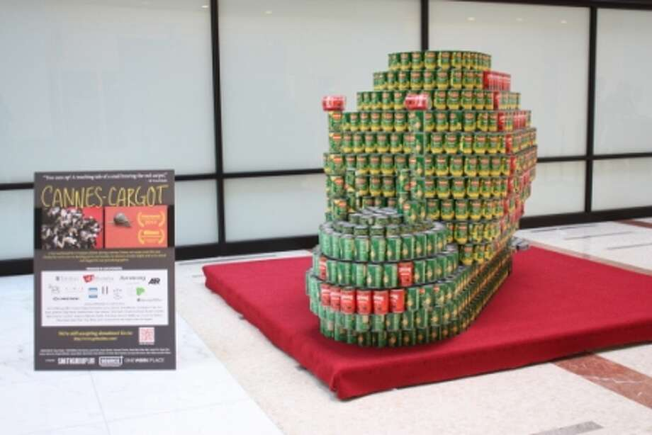 "CANNES-cargot (Smithgroupjjr): ""A lost snail found his 15 minutes of fame during a stormy Cannes red carpet event this year ... Our CANStruction team is inspired by the uninvited guest -- from the spherical shell to the gelatinous antenna, we knew a challenge was ahead in our structure's design and construction."""