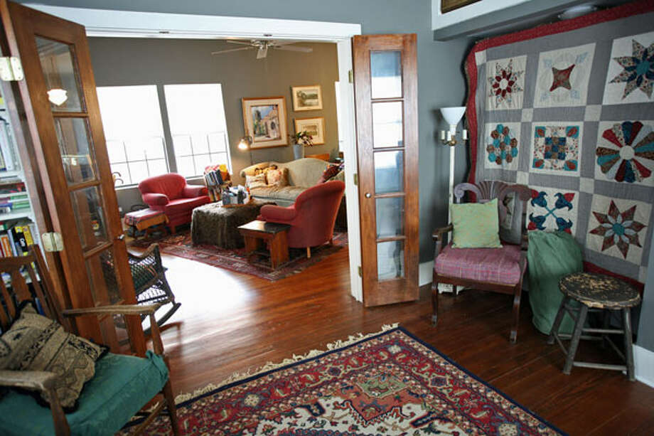 A sampler quilt conceals the Murphy bed in the front bedroom, which Janyce Sisson uses as a study.