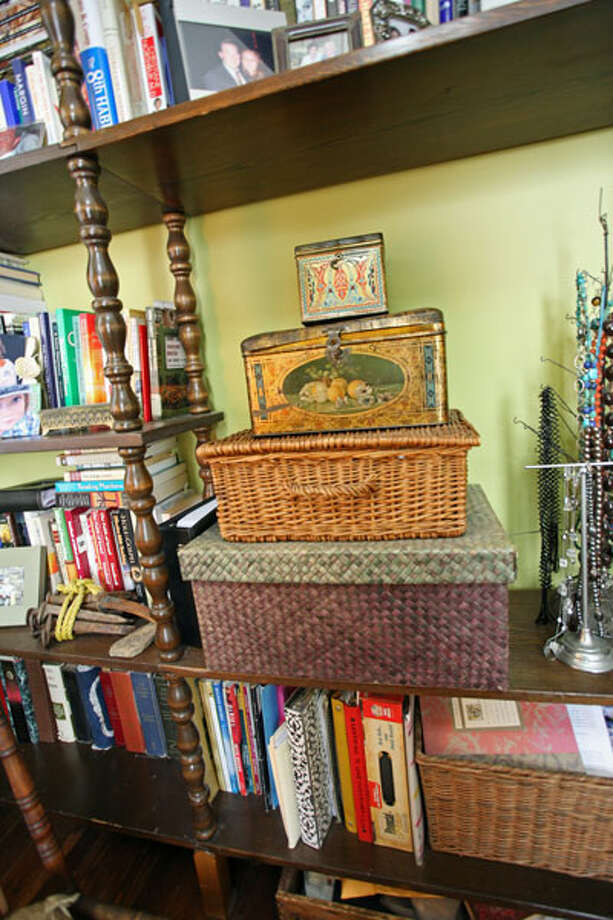 Baskets are dual purpose at Janyce Sisson's house: they make attractive displays while being used as storage.