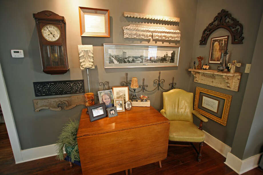 Eliminating a hallway allowed Janyce Sisson to expand the width of her dining room; a drop-leaf table holds pictures.
