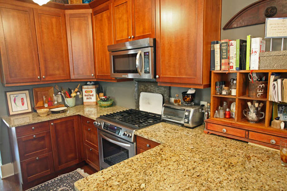 Janyce Sisson updated the kitchen with new cabinets and granite countertops.