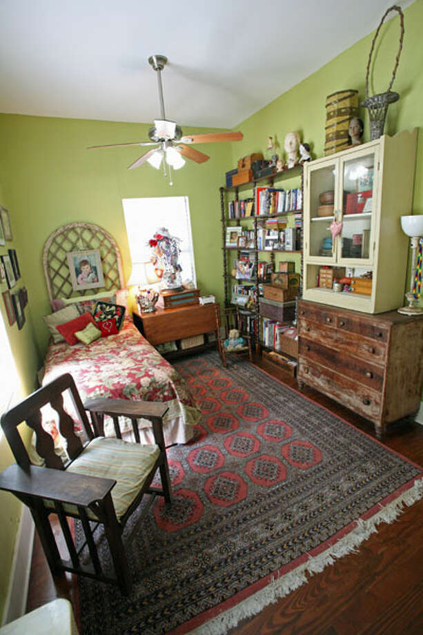 The antique dresser at right belonged to Janyce Sisson's mother. The shelves next to the dresser hold books and family mementos.