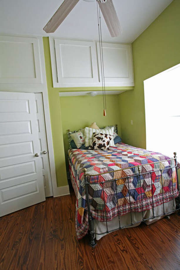 Janyce Sisson had a nook created for the bed in the guest bedroom, which is painted chartreuse.