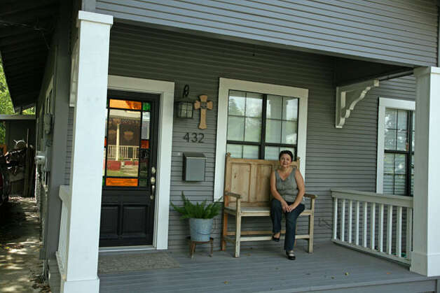 Janyce Sisson on the front porch of her Lavaca Historic District home.
