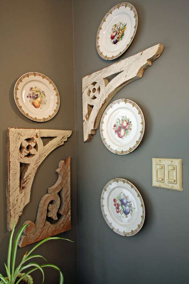 Plates painted with fruit designs are displayed on the dining room wall.