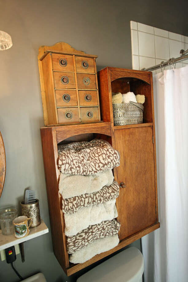 Janyce Sisson uses spice drawers that her mother got in Germany as a storage piece in the bathroom.