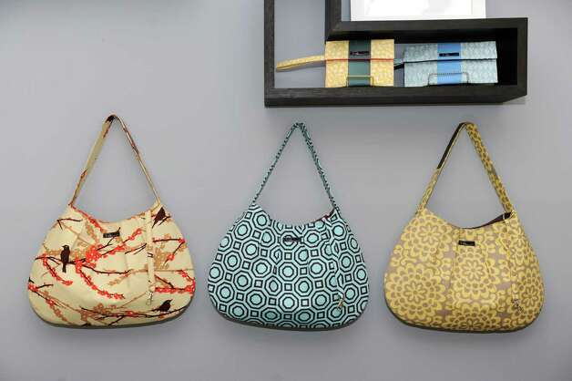 Three Sweet Pea Hobo handbags made by store owner Petra Jancovicova selling for $78 each at Boutique No. 5 on Friday, Nov. 9, 2012 in Troy, N.Y.  (Lori Van Buren / Times Union) Photo: Lori Van Buren