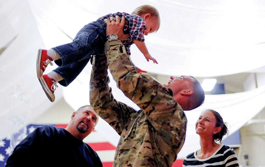 Who: Army Sgt. Neil Casey and his 1-year-old son, Aiden. Where: Fort Carson, Colo. When: Nov. 12, 2012. Details: The unit came home on Veterans Day. Photo: Michael Ciaglo, Associated Press / The Gazette