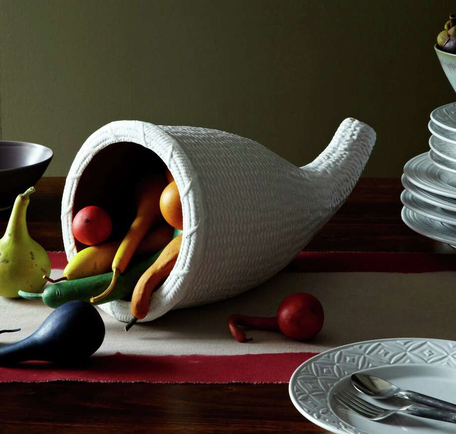 Fill a terra-cotta cornucopia from West Elm with goodies. Photo: Associated Press / West Elm