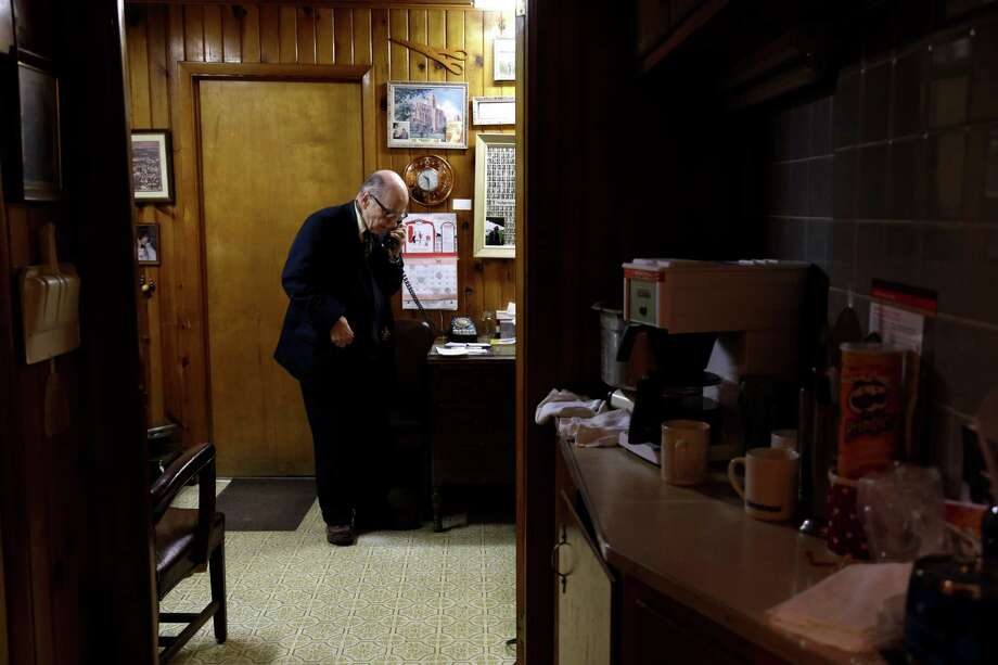 In this Tuesday, Oct. 30, 2012 photo, Dr. Russell Dohner makes a phone call in his office in Rushville, Ill. Even when the medical profession changed around him, he was always on call, ready to drop everything for a patient who might need him. Photo: Jeff Roberson, AP / AP