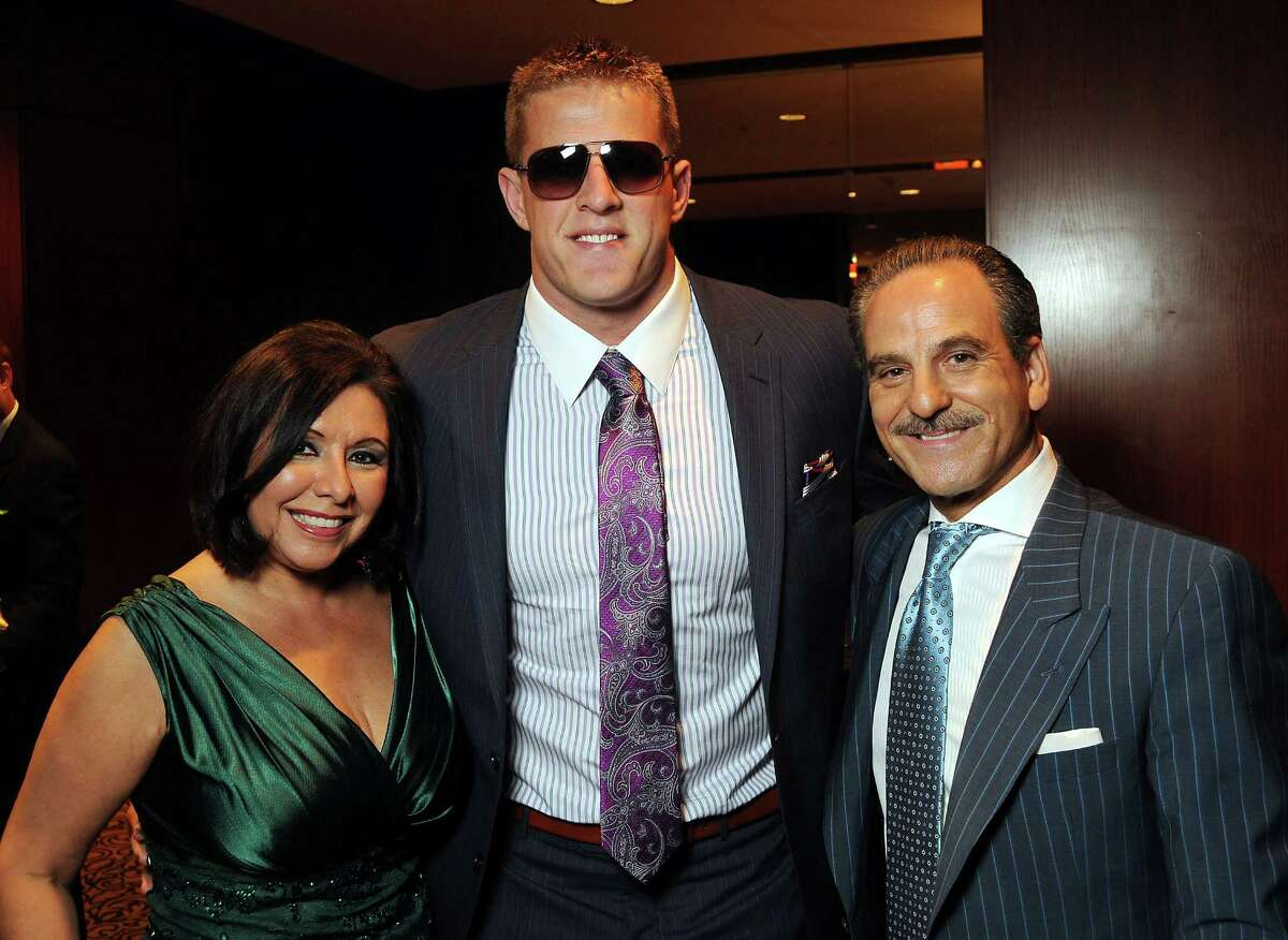 """Houston Texans star J.J. Watt, center, with honorary chairs Debbie and Rudy Festari at """"Una Notte in Italia"""""""