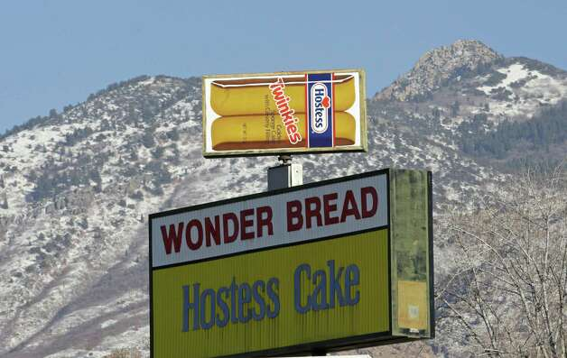 A Hostess Twinkies sign is shown at the Utah Hostess plant in Ogden, Utah, Thursday, Nov. 15, 2012. Hostess Brands Inc. said it likely won't make an announcement until Friday morning on whether it will move to liquidate its business, after the company had set a Thursday deadline for striking employees to return to work. The maker of Twinkies, Ding Dongs and Wonder Bread said Thursday it will file a motion in U.S. Bankruptcy Court to shutter operations if enough workers don't return by 5 p.m. EST. That would result in the loss of about 18,000 jobs, including hundreds in Ogden. (AP Photo/Rick Bowmer) Photo: Rick Bowmer, STF / AP