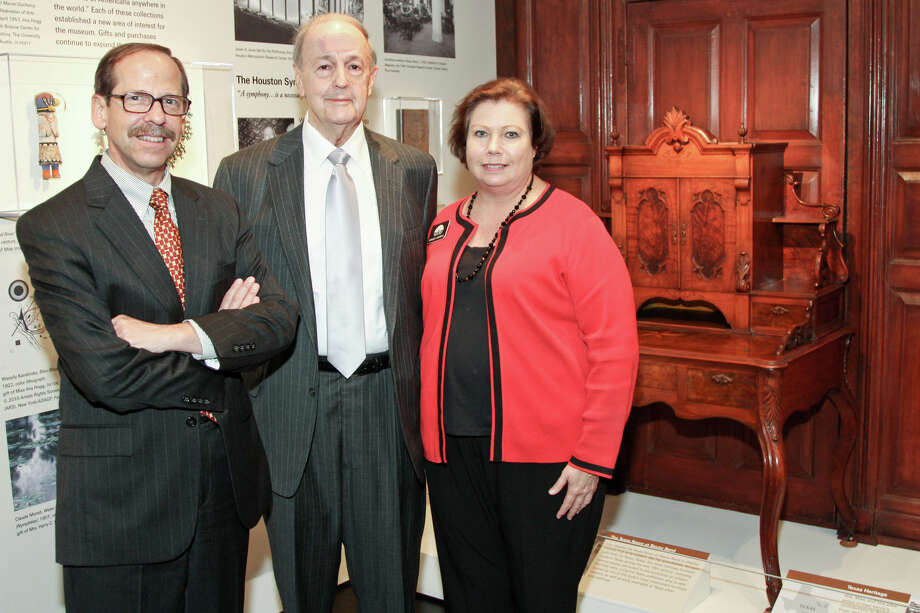 Oilman and antiques collector William J. Hill, center, has donated an exquisite Adoph Kepmen desk and 150 pieces of early Texas pottery in his latest gift to Bayou Bend. He's shown with Bayou Bend curator Michael Brown and director Bonnie Campbell. Photo: Kim Coffman