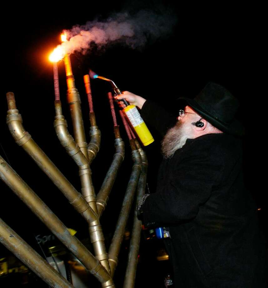 Rabbi Stock from Congregation Mishkan Israel in Trumbull lights a giant Menorah in Jennings Park, in Fairfield, Conn. on Tuesday evening, Dec. 15th, 2009. Photo: Ned Gerard / Connecticut Post