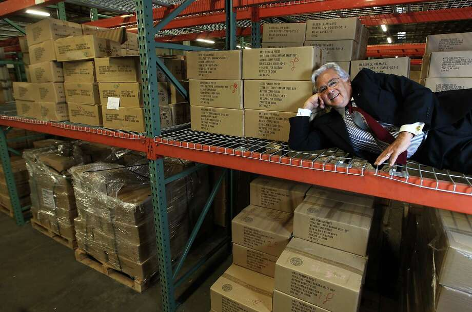 Founder and director of Arte Público, Nicolas Kanellos, 67, lies on a shelf in Arte Público's new warehouse in their new building at UH, Thursday, Oct. 25, 2012, in Houston. Arte Público press, the oldest and largest publisher of U.S. Hispanic literature in the country.  as recently as last year, Kanellos and his staff of 40 shuttled between three UH offices and a vermin-infested warehouse to do their jobs. Now, all the offices are housed together. Emilio Sanchez lithographs hang on the walls. And the attached warehouse - as big as a football field - bears no signs of scurrying paper-eaters. After 33 years, Arte Público Press has found a proper home. ( Karen Warren / Houston Chronicle ) Photo: Karen Warren, Staff / Houston Chronicle