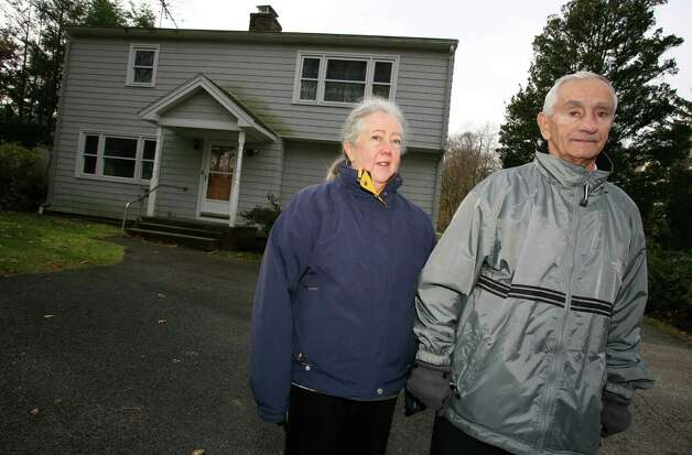 Cos Cob residents Barbara and Anthony Lovallo in front of their home at 90 Orchard Street Friday, Nov. 16, 2012. Photo: DAVID AMES / GREENWICH TIME FREELANCE