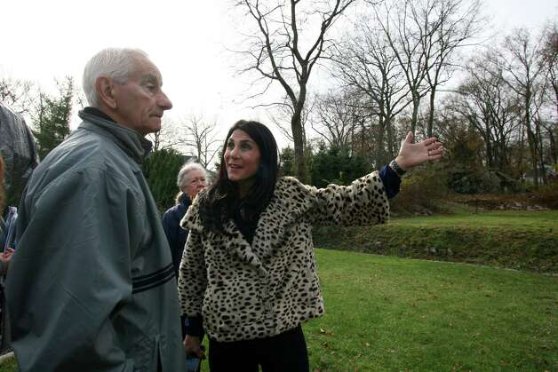 Cos Cob neighbors Anthony Lovallo, left, and Valerie Olivieri discuss the purchase of a piece of property on Orchard Street the Greenwich Reform Synagogue is hoping to build on during a meeting Friday, Nov. 16, 2012. Photo: DAVID AMES / GREENWICH TIME FREELANCE