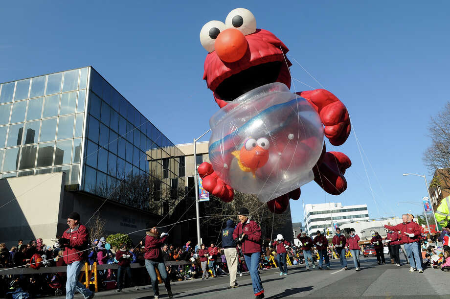 The Elmo balloon makes its way down Summer Street for the UBS Parade Spectacular in downtown Stamford on Sunday, November 21, 2010. Photo: Shelley Cryan / Shelley Cryan freelance; Stamford Advocate Freelance