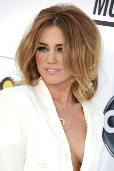 Here's Miley pre-haircut in May, as she arrives at the 2012 Billboard Music Awards in Las Vegas.