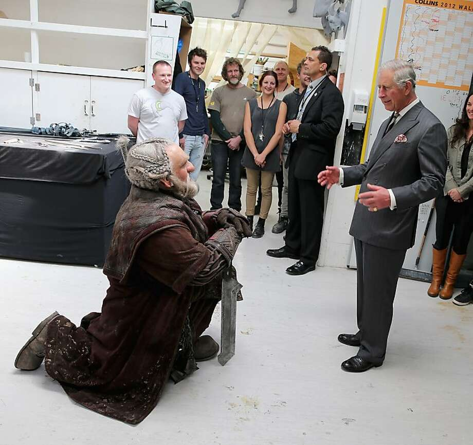 "Actually I prefer 'little person,' Your Highness: Dori the dwarf (Mark Hadlow) bows before Prince Charles at Weta Workshop in Wellington, New Zealand. Tolkien readers will recall that Dori was one of the dwarfs who befriended Bilbo in ""The Hobbit,"" the prequel to the ""Lord of the Rings"" and a new motion picture from Peter Jackson. Photo: Chris Jackson, Getty Images"