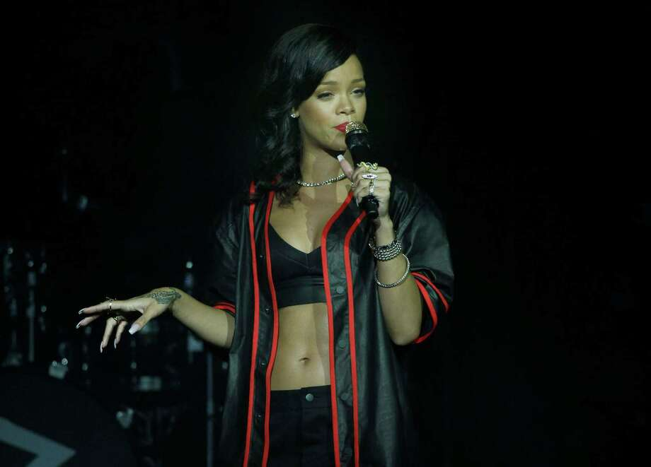 Rihanna performs during the first stop of her 777 worldwide tour at the Plaza Condesa in Mexico City, Wednesday, Nov. 14, 2012. (AP Photo/Marco Ugarte) Photo: Marco Ugarte, Associated Press / AP