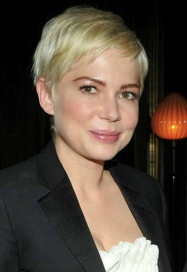 "Michelle Williams cut her hair off in favor of a pixie cut in 2007. Not everyone likes the style, but the actress said in 2011 that she keeps it short in memory of her late partner, Heath Ledger, ""the one straight man who has ever liked short hair."" Photo: Stephen Lovekin, Getty Images / Getty Images North America"