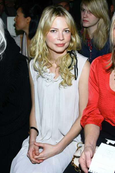 A pre-pixie Michelle Williams attends a fashion show in February 2007.