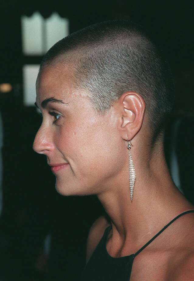 "Demi Moore shaved her head on camera in 1997, as part of her role in the film ""G.I. Jane."" Moore told TheInsider.com recently that she felt a sense of strength and power as the hair came off.  Photo: ALBERT FERREIRA, Associated Press / AP"