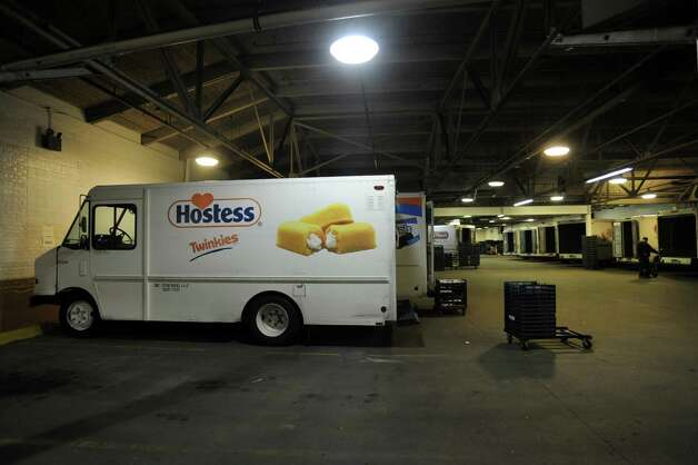 Drivers for Hostess Brands Inc. return from morning deliveries to the facility Wells Street in Bridgeport, Conn. on Friday, Nov. 16, 2012. The company announced itâÄôs going out of business meaning the loss of about 18,500 jobs. Hostess employs about 200 workers in Connecticut in non-bakery retail and distribution facilities. Photo: Cathy Zuraw / Connecticut Post