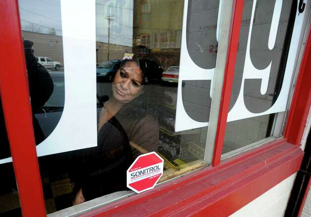 Marisol Sanchez, a cleck at the Wonder Bread Bakery Outlet, looks out the window of the store on Wells Street in Bridgeport, Conn. on Friday, Nov. 16, 2012. Hostess Brands Inc. announced  itâÄôs going out of business meaning the loss of about 18,500 jobs. Hostess employs about 200 workers in Connecticut in non-bakery retail and distribution facilities. The 50 employees in Bridgeport are caught in a fight between management and The Bakery Confectionery, Tobacco Workers and Grain Millers International Union, which went on strike last week. Photo: Cathy Zuraw / Connecticut Post