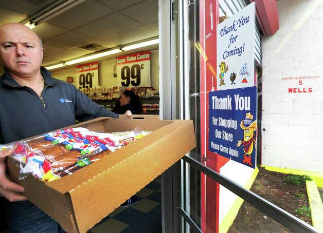 A customer stocks up on Wonder Bread at the Bakery Outlet on Wells Street in Bridgeport, Conn. on Friday, Nov. 16, 2012. The company announced itâÄôs going out of business meaning the loss of about 18,500 jobs. Hostess employs about 200 workers in Connecticut in non-bakery retail and distribution facilities. Photo: Cathy Zuraw / Connecticut Post