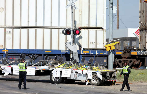 Members of the Midland Police Department works the scene of the crash, Friday Nov. 16, 2012, involving a Union Pacific train and a parade float carrying military veterans in Midland, Tx. Four veterans were killed in the accident which occurred Thursday afternoon. Photo: Edward A. Ornelas, San Antonio Express-News / © 2012 San Antonio Express-News
