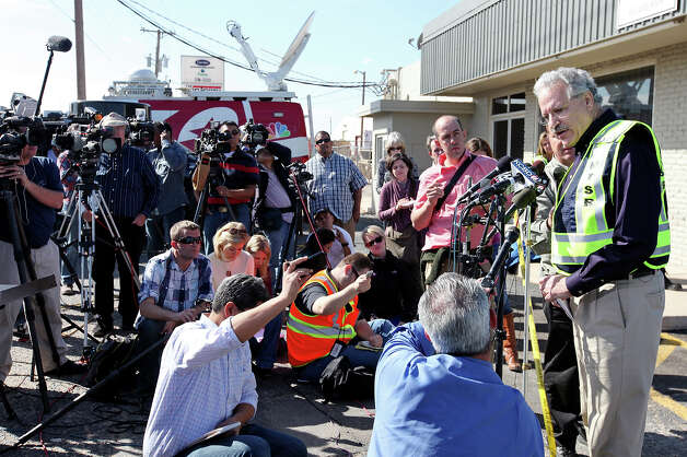 National Transportation Safety Board member Mark Rosekind (right) speaks during a press conference at the scene of the crash, Friday Nov. 16, 2012, involving a Union Pacific train and a parade float carrying military veterans in Midland, Tx. Four veterans were killed in the accident which occurred Thursday afternoon. Photo: Edward A. Ornelas, San Antonio Express-News / © 2012 San Antonio Express-News