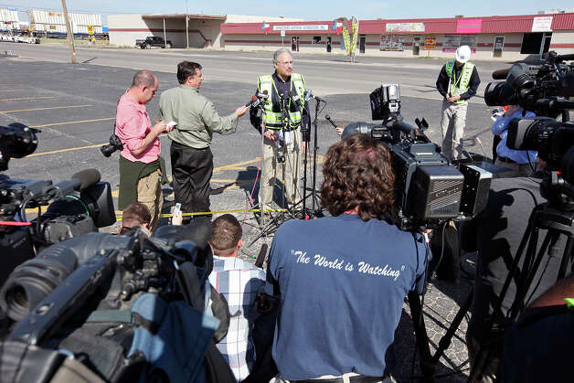 National Transportation Safety Board member Mark Rosekind (center) speaks during a press conference at the scene of the crash, Friday Nov. 16, 2012, involving a Union Pacific train and a parade float carrying military veterans in Midland, Tx. Four veterans were killed in the accident which occurred Thursday afternoon. Photo: Edward A. Ornelas, San Antonio Express-News / © 2012 San Antonio Express-News
