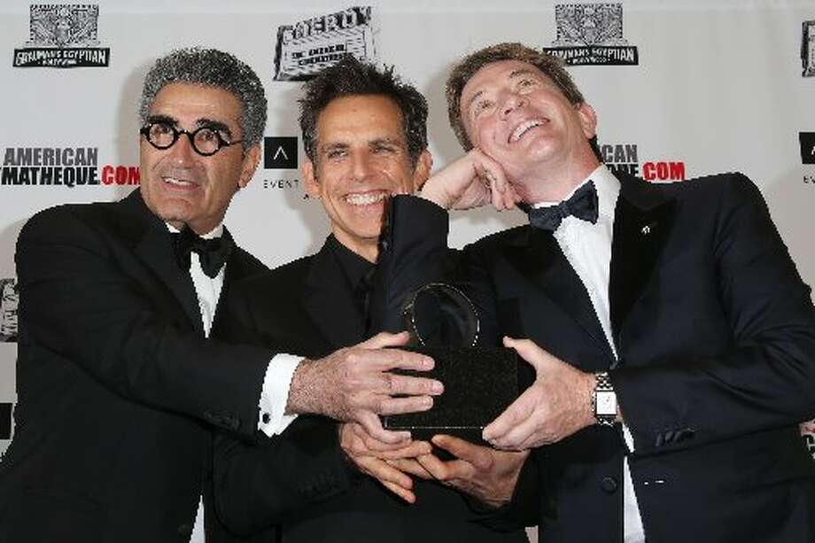 (L-R) Actors Eugene Levy, honoree Ben Stiller and Martin Short pose with the American Cinematheque Award during the photo op at the the 26th American Cinematheque Award Gala honoring Ben Stiller at The Beverly Hilton Hotel on November 15, 2012 in Beverly Hills, California. (Photo by Frederick M. Brown/Getty Images) (Getty)