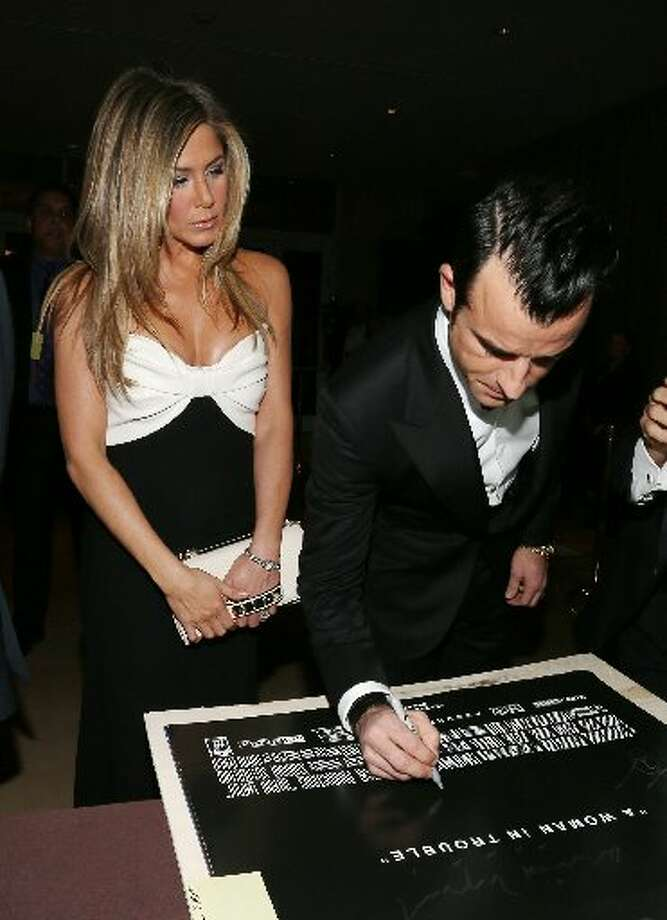 Actors Jennifer Aniston and Justin Theroux attend the 26th American Cinematheque Award Gala honoring Ben Stiller at The Beverly Hilton Hotel on November 15, 2012 in Beverly Hills, California. (Photo by Frederick M. Brown/Getty Images) (Getty)
